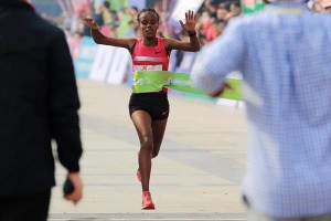 Mare Dibaba winning at the Xiamen international maraton