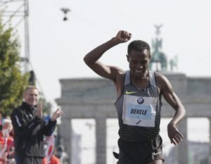 Kenenisa Bekele of Ethiopia celebrates winning the men's competition at the Berlin marathon in Berlin, Germany, September 25, 2016. REUTERS/Fabrizio Bensch